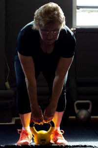 Older women lifting kettlebell Scotland All-Strong Perth Fitness Classes
